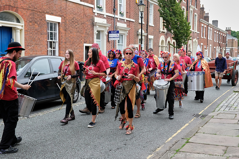 Worldwise Samba Drummers lead the procession from Latham St