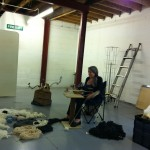 Artist Evelyn Rose working on her installation