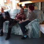 Visitors relax on a comfy sofa whilst listening to live music and enjoying the art